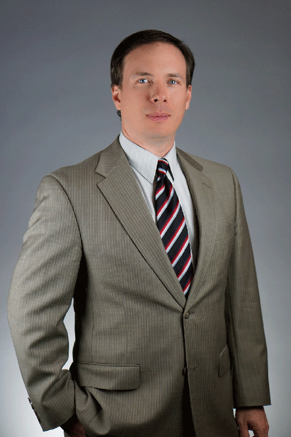 Evan Taylor Standing in a Suit